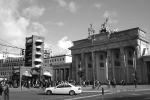 at crossroads - brandenburg gate, berlin